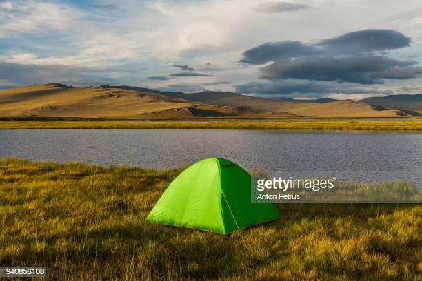 Green tent on the Plateau Ukok, Altai mountains, Siberia, Russia