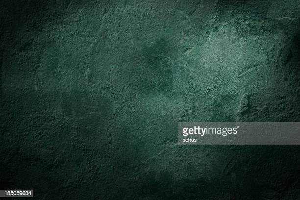 Green textured wall.