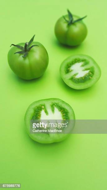 green tomatoes - catherine macbride stock pictures, royalty-free photos & images