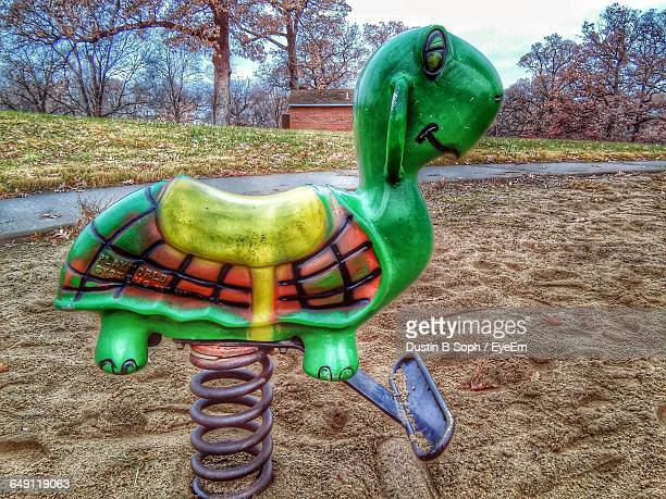 green tortoise shape play equipment at playground - animal representation stock pictures, royalty-free photos & images