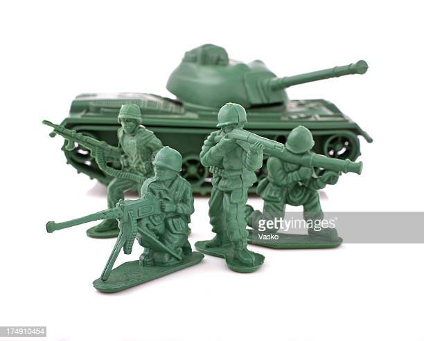 Green toy soldiers and an army tank