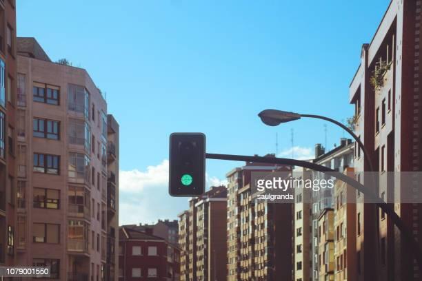 green traffic light in a residential district - asturien stock-fotos und bilder