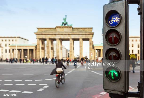 green traffic lights for cyclists at the brandenburger tor (brandenburg gate) - city gate stock pictures, royalty-free photos & images