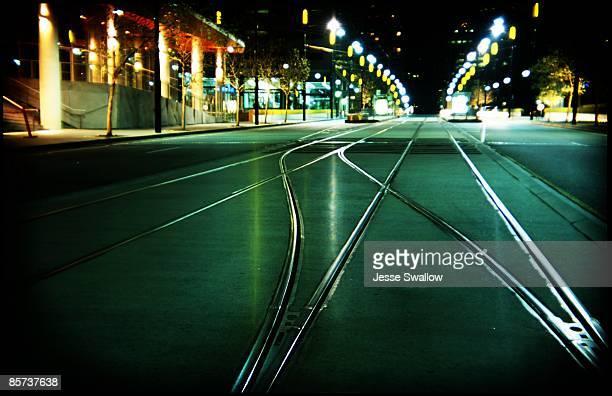 Green tram tracks by night