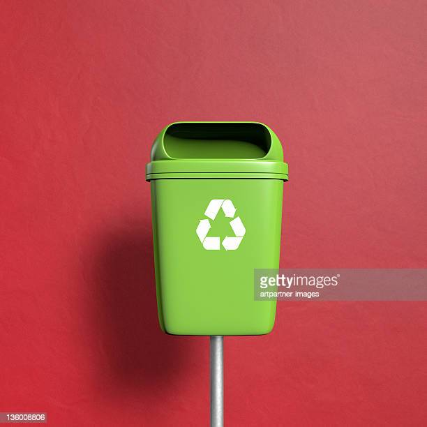 green trash with recycling symbol on red - garbage bin stock pictures, royalty-free photos & images