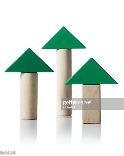 Green triangles on wooden blocks