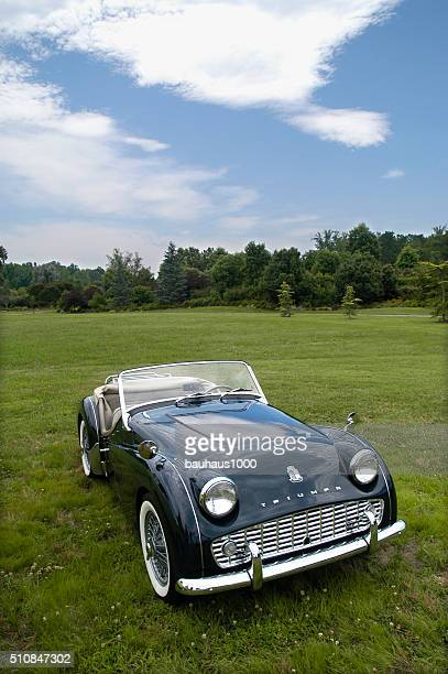 green triumph roadster--european classic sports car - triumph motorcycle stock pictures, royalty-free photos & images