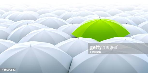 Green umbrella. Different, leader, unique, boss, individuality, original, special concept