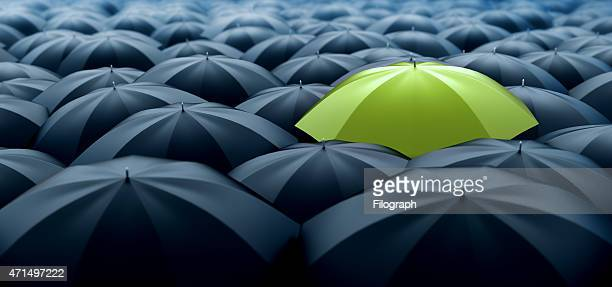 green umbrella - individuality stock photos and pictures