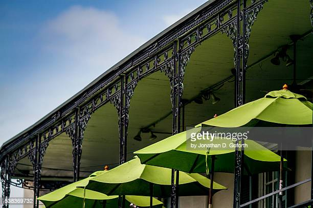 green umbrellas - french quarter stock photos and pictures