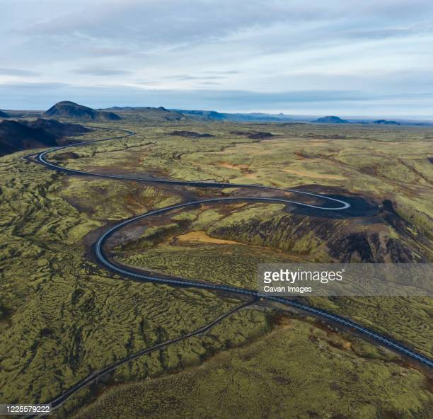 green valley with curvy road - narrow stock pictures, royalty-free photos & images