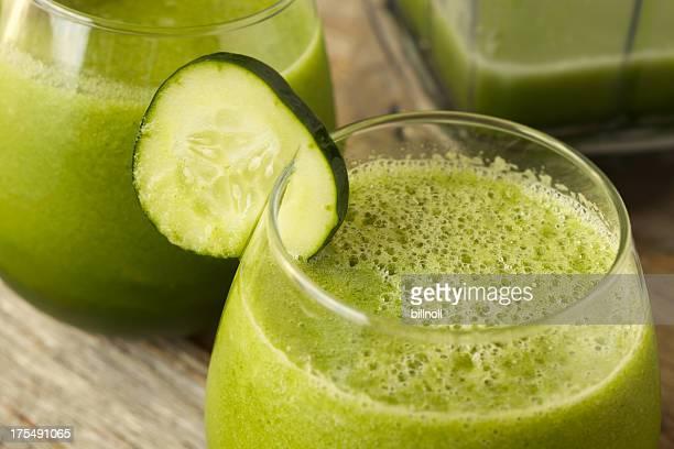 Green vegetable juice with cucumber garnish