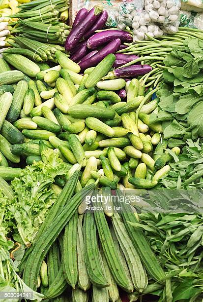green vegetables at the market - loofah stock photos and pictures