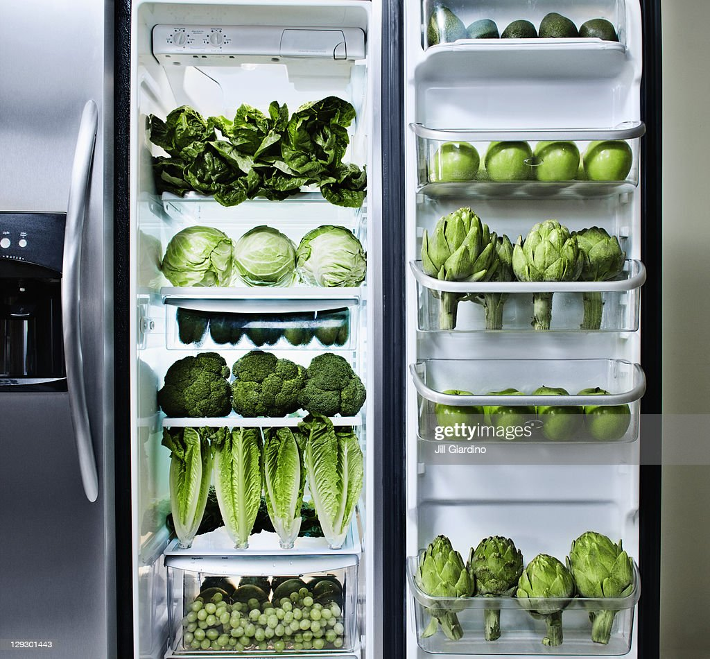 Green vegetables in refrigerator : Stock Photo