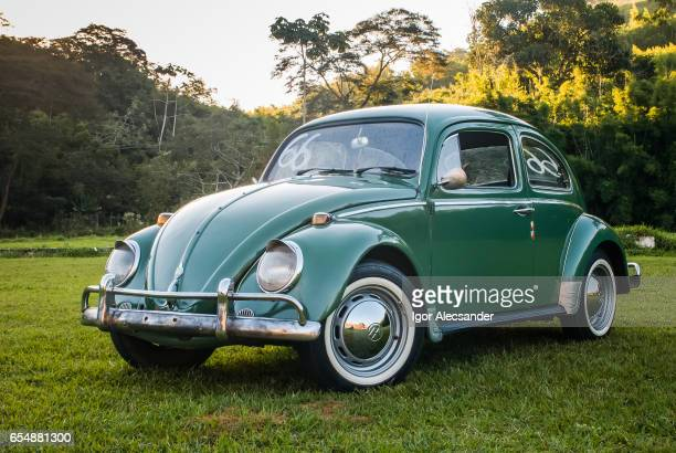 green volkswagen beetle or bug - volkswagen stock pictures, royalty-free photos & images