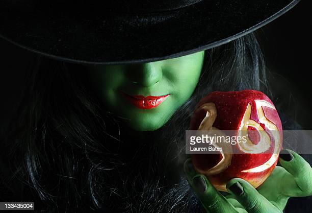 Green witch with apple in hand