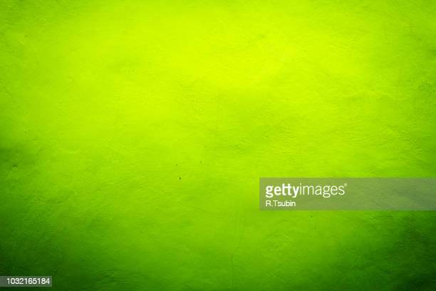 Green with yellow lime texture background with bright center spotlight