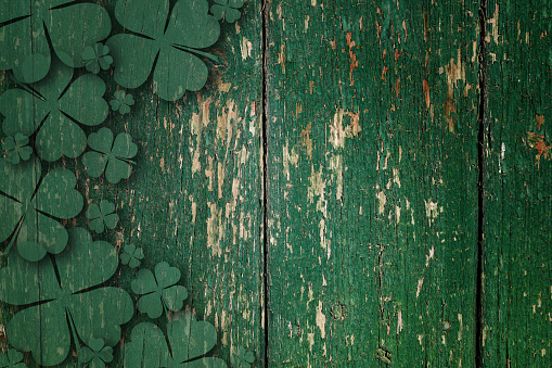 Green wooden four leaf shamrocks on wooden board 1132924082