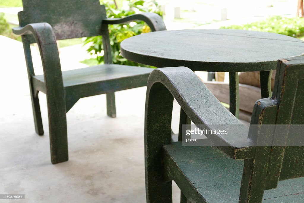 green wooden table and chair : Stockfoto