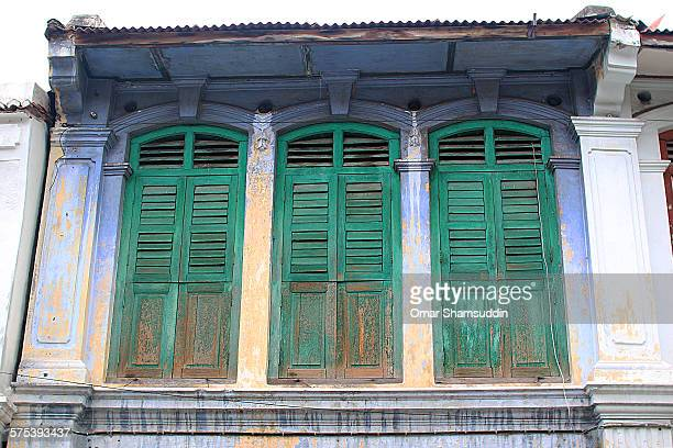 green wooden windows - omar shamsuddin stock pictures, royalty-free photos & images
