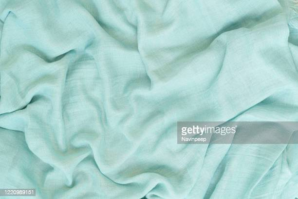 green wrinkled bedsheets - mint green stock pictures, royalty-free photos & images