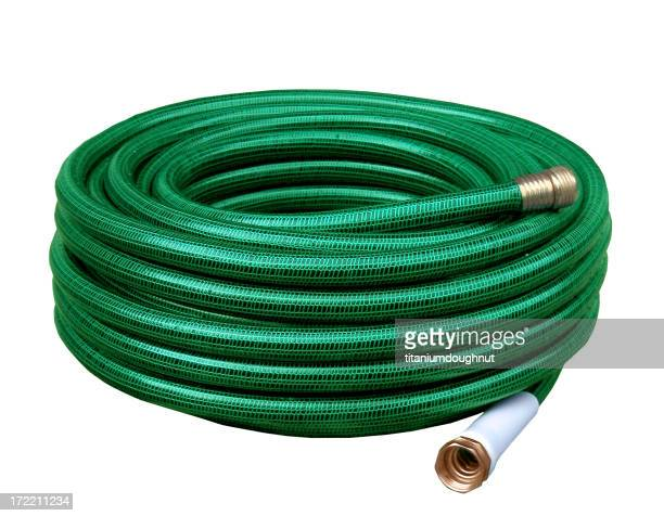 Green yard hose coiled up for storage