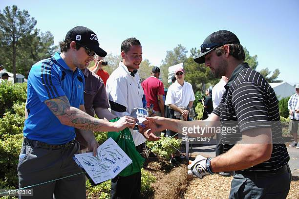 Greenbay Packers Quarterback Aaron Rodgers signs autographs at the 11th Annual Michael Jordan Celebrity Invitational hosted by Aria Resort Casino at...