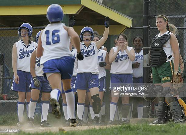High school softball Sherwood at Damascus on Tuesday April 24 2007 Sherwood pitcher Dana Ward is met at the plate by her teammates after hitting a...