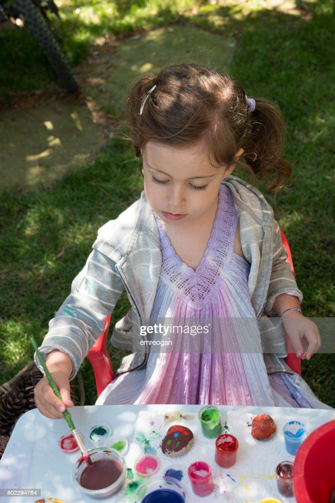 Little Girl Sitting On Rock # 229