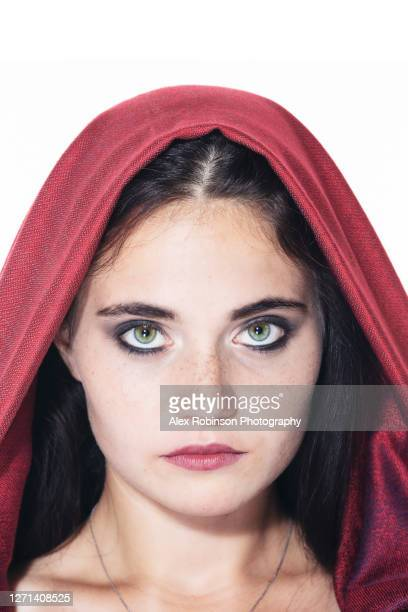 a green-eyed woman in a red veil - headdress stock pictures, royalty-free photos & images