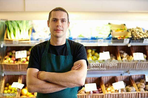 greengrocer in his shop - 35 year old man stock pictures, royalty-free photos & images
