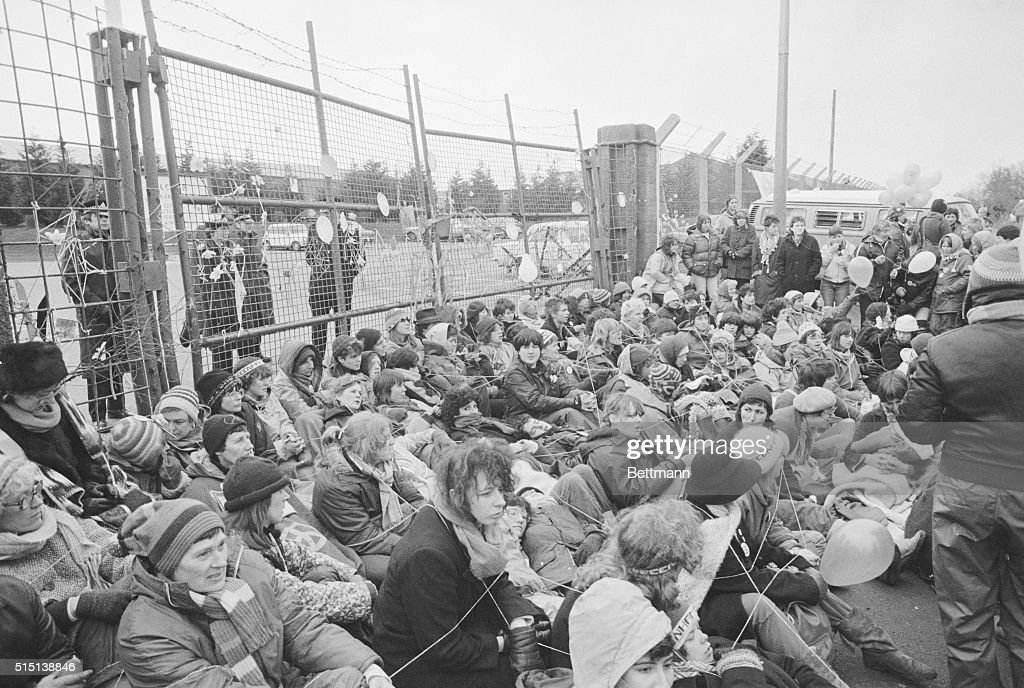 Demonstrators block the gates of the Greenham Common Airbase, England tied together with string. The demonstrators were among thousands of Campaign for Nucleur Disarmament followers (CND) forming an Easter protest for peace.