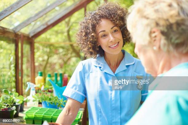 greenhouse care worker - house call stock photos and pictures