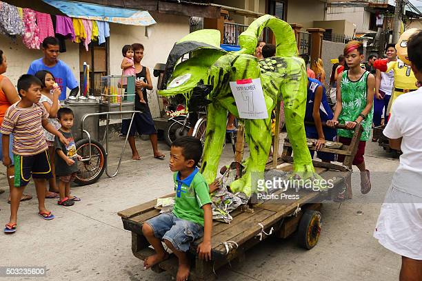A greenish creature effigy was being paraded in the street