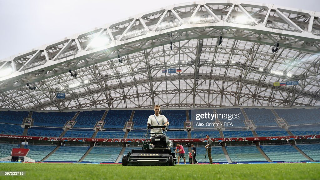A greenkeeper mows the grass on the pitch prior to a Germany training session during the FIFA Confederations Cup Russia 2017 at Fisht stadium on June 18, 2017 in Sochi, Russia.