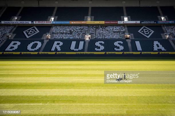 Greenkeeper of Borussia Moenchengladbach prepares the pitch of Borussia-Park on May 15, 2020 in Moenchengladbach, Germany.