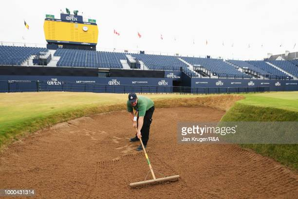 Greenkeeper rakes a bunker during previews to the 147th Open Championship at Carnoustie Golf Club on July 17, 2018 in Carnoustie, Scotland.