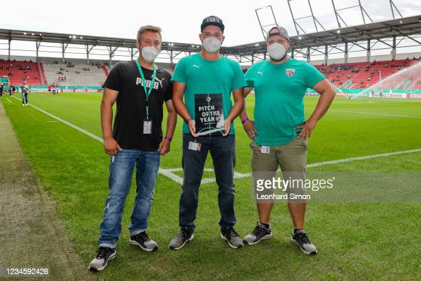 Greenkeepers Dominique Weber, Matthias Gernetht and Christopher Maid receive the award PITCH OF THE YEAR ahead of the DFB Cup first round match...