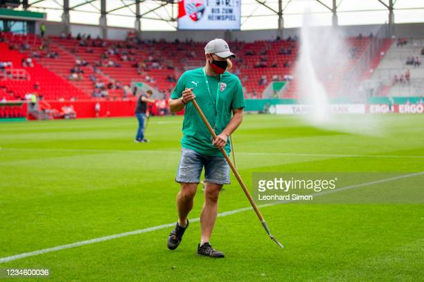 Greenkeepers of FC Ingolstadt 04 at work ahead of the DFB Cup first round match between FC Ingolstadt 04 and Erzgebirge Aue at Audi Sportpark on...