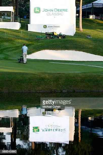 Greenkeepers prepare the course prior to the start of the first round of the John Deere Classic at TPC Deere Run on August 11 2016 in Silvis Illinois