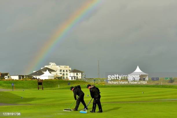 Greenkeepers remove water as the start of play is delayed due to bad weather during Strokeplay on Day One of The Women's Amateur Championship at The...