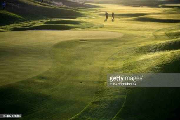 TOPSHOT Greenkeepers work before a practice session ahead of the 42nd Ryder Cup at Le Golf National Course at SaintQuentinenYvelines southwest of...