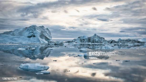 greenland icebergs sunset cloudscape panorama - iceberg ice formation stock pictures, royalty-free photos & images