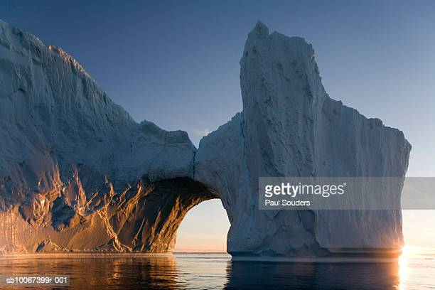 greenland, ilulissat, arched iceberg from ilulissat kangerlua glacier - arch stock pictures, royalty-free photos & images