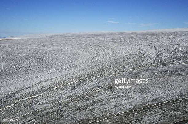QAANAAQ Greenland Photo taken July 20 from a helicopter chartered by a Japanese expedition team to the North Pole shows a glacier in Qaanaaq...