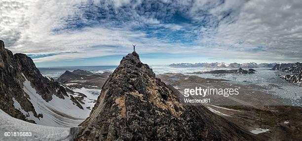 Greenland, Schweizerland, Kulusuk, mountaineer on mountaintop