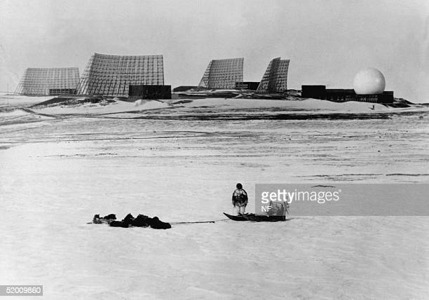 Greenlander with his dog sleigh looks at the radars at Thule Air Base in Northern Greenland in 1966 Denmark's Supreme Court ruled 28 November that...