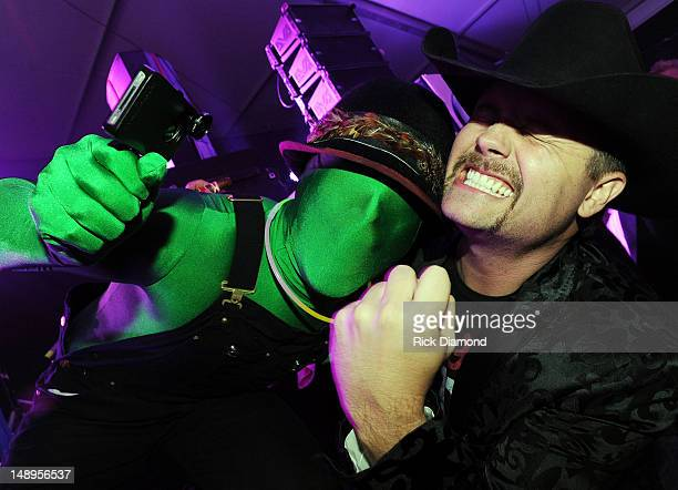 Greenman notices John Rich in the audience during the World Premier of Big Kenny's Electro Country Shine at Country Thunder Day 1 on July 19 2012 in...