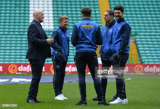 Greenock Morton manager Jim Duffy talks with his players on the Celtic park pitch ahead of the Scottish Cup Quarter Final match between Celtic and...