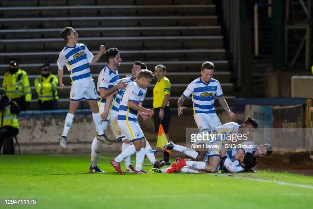 Thomas O'Ware celebrates with team mates after scoring his side's first goal